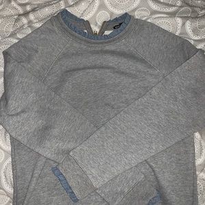 Gray sweater with blue detailing